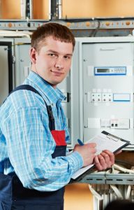 One electrician working with distribution fuseboard
