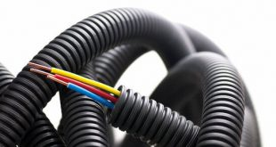 tubing of electrical copper cables for electrician with 3 colors red, blue, and green yellow the externel sheath is black. Isolated over white background